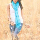 Country Girl Walking Through A Field